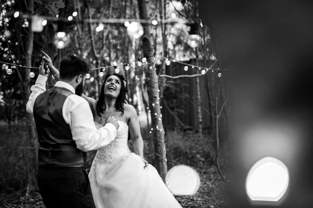 A bride and groom enjoy a fairly light lit first dance