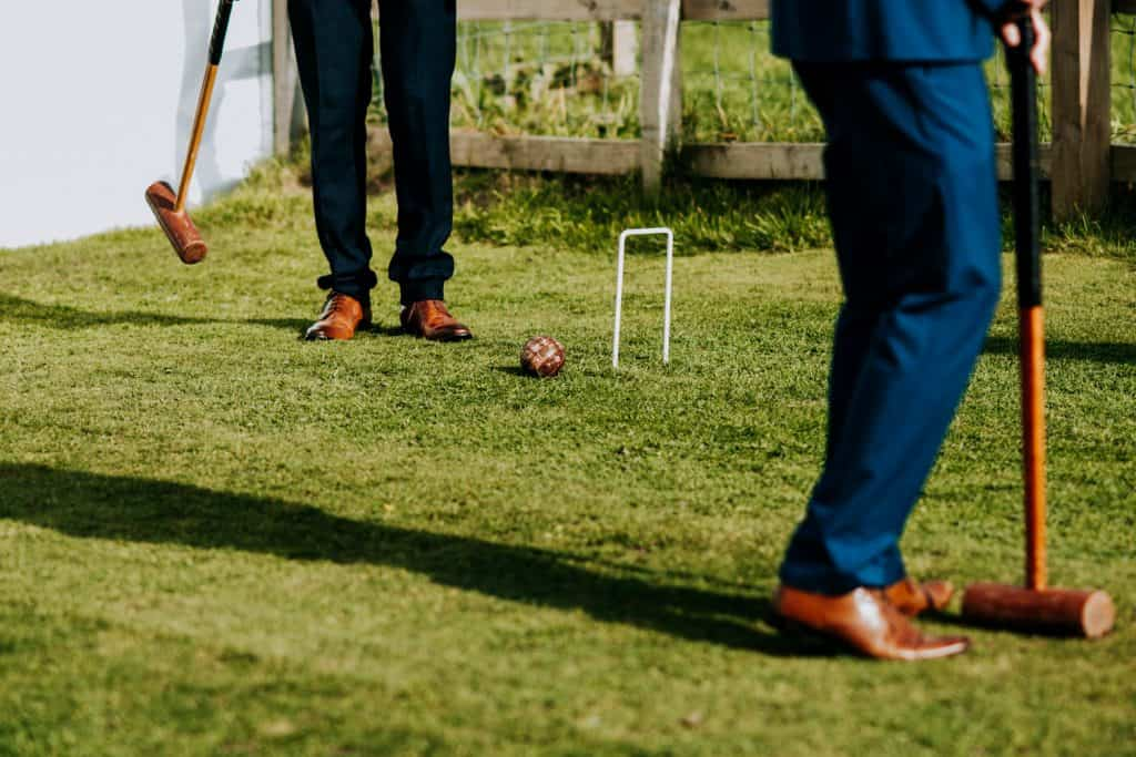 Guests playing garden games during a wedding morning