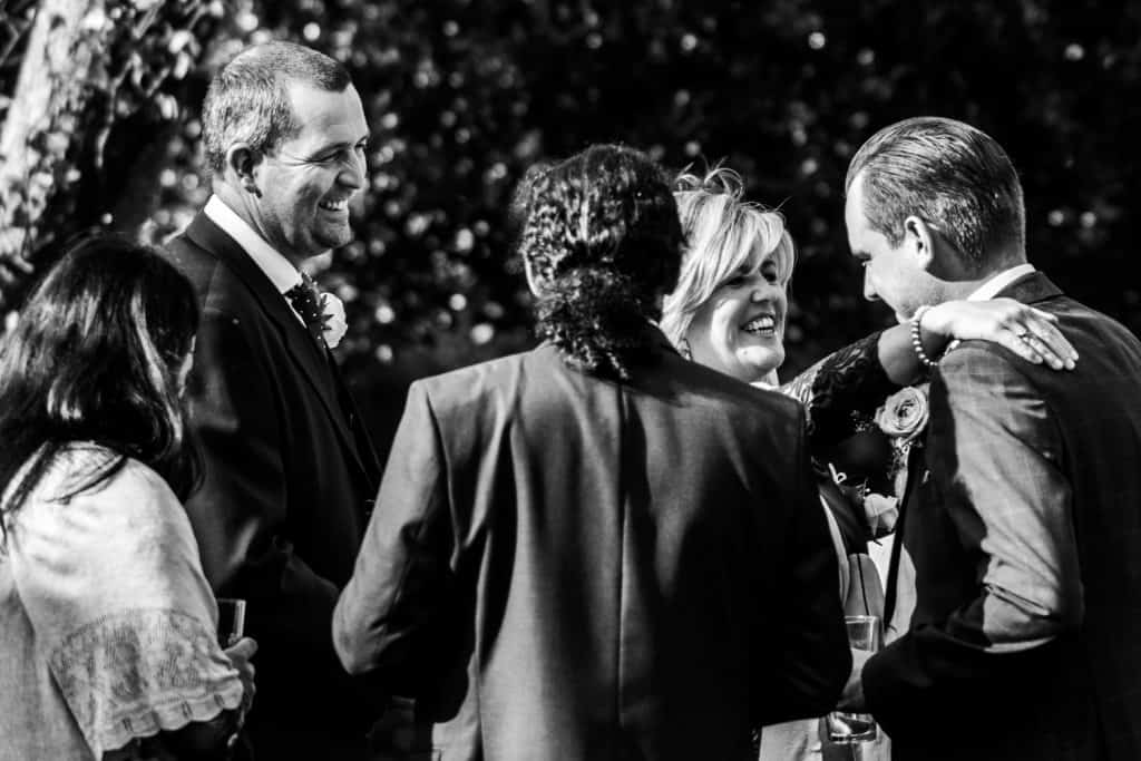 Wedding guests laugh together