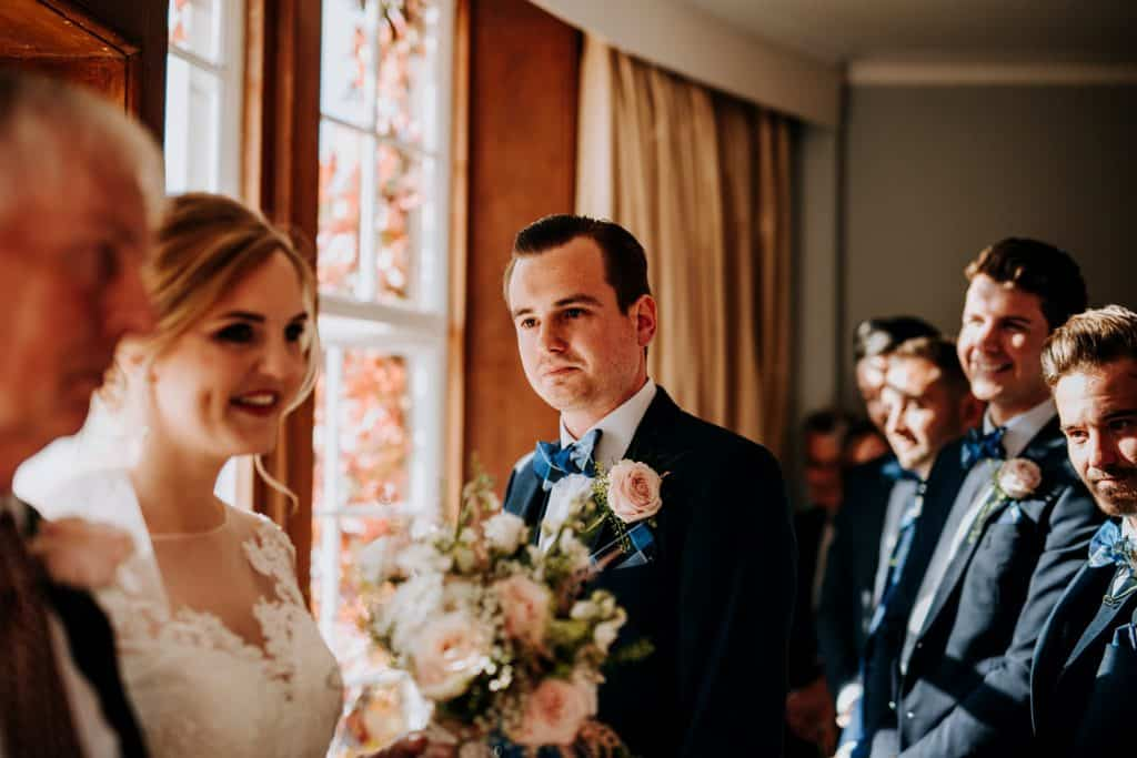 A groom is very emotional at his wedding ceremony
