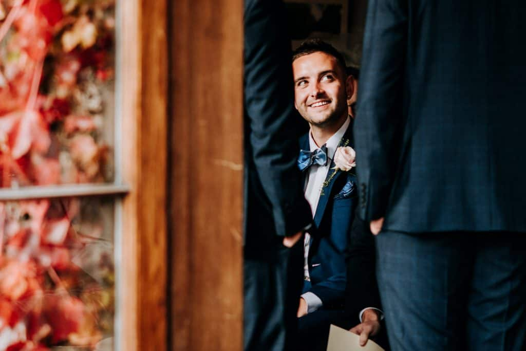 A wedding guest smiles at Hilltop Country House