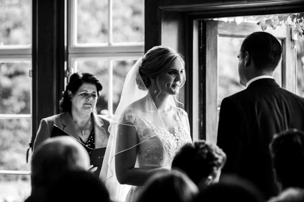 Bride and groom get married at a country house surrounded by guests