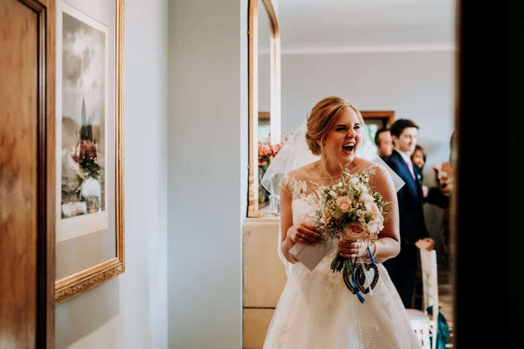 A bride laughs during her wedding day