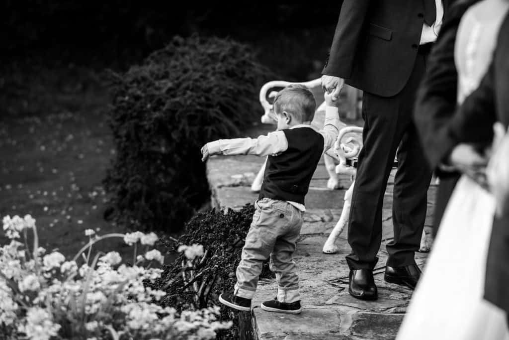 A young guest plays at a wedding