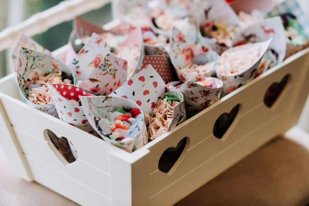 Wedding confetti lies waiting to be picked up