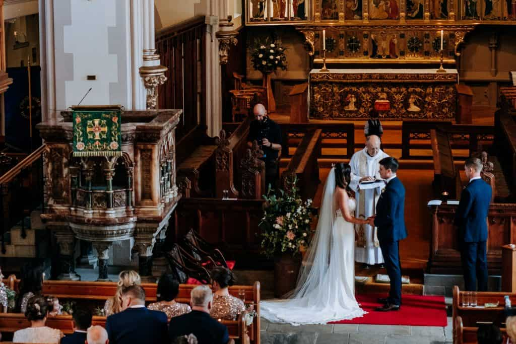 A photo showing the whole church during a wedding ceremony