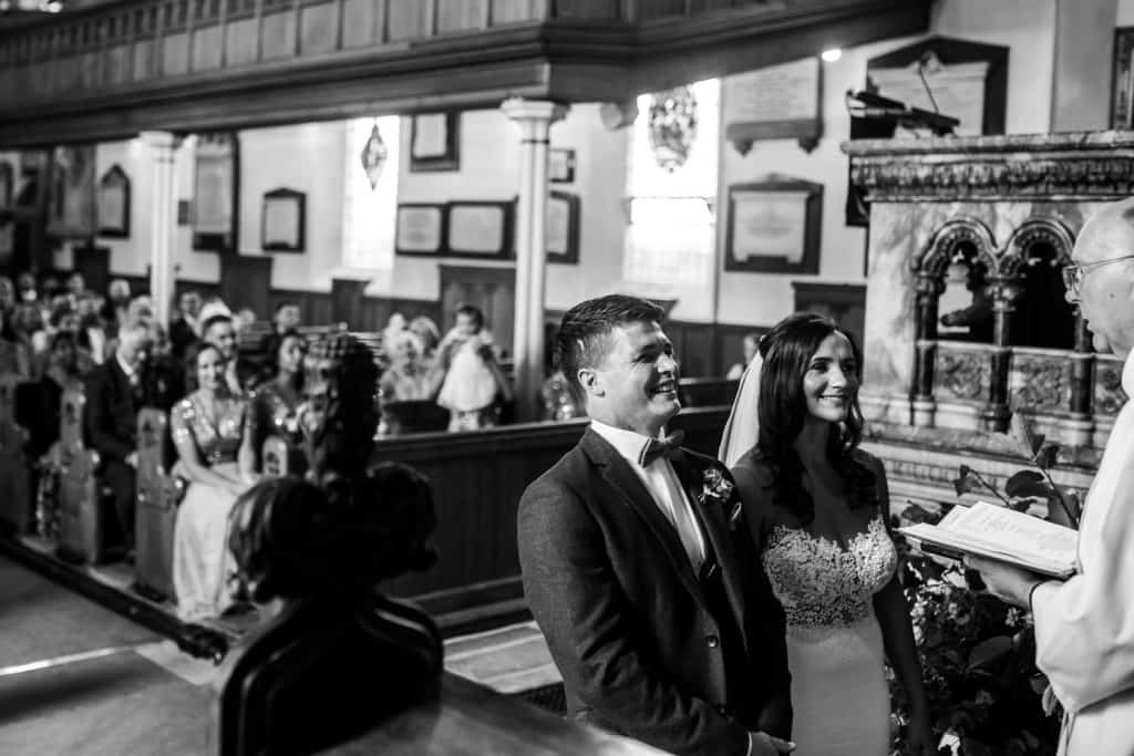 A photo of a happy couple during their wedding at a church in Harrogate