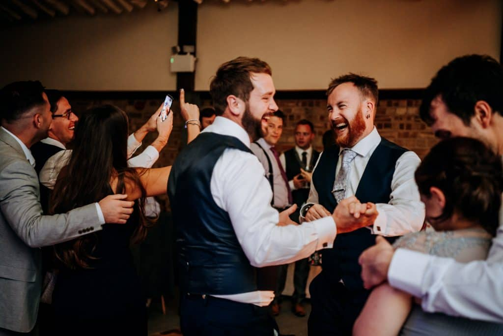 Wedding guests dancing to live band at Beverley Barn