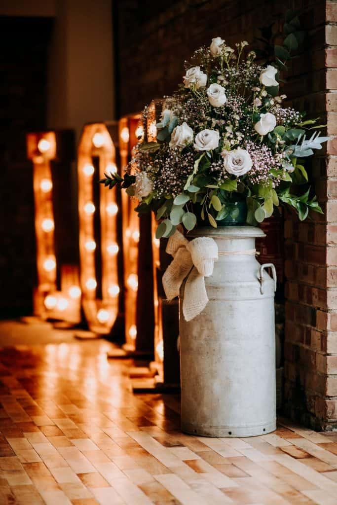 milk churn flower arrangement at the Beverley Barn