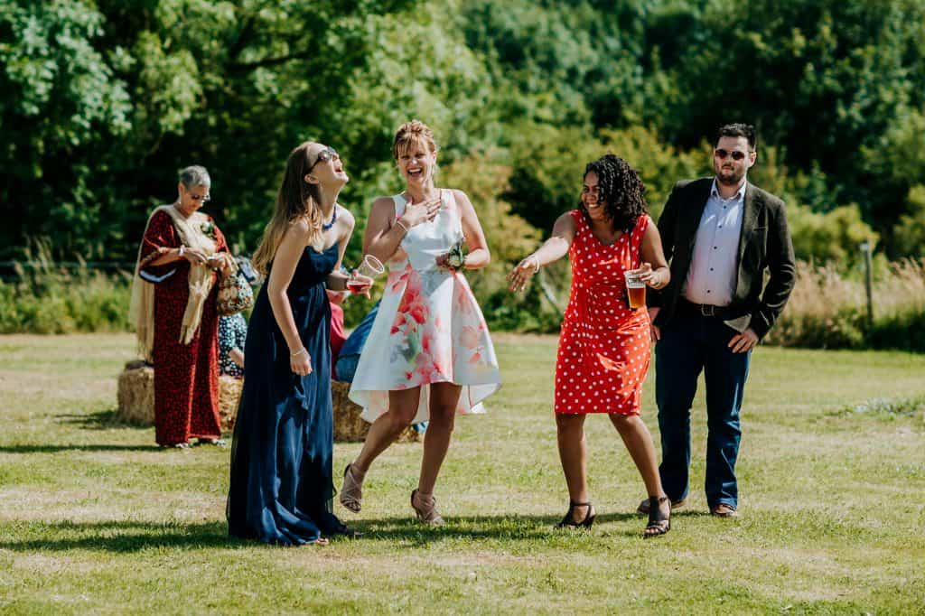 laugher between guests at a lovely summer wedding