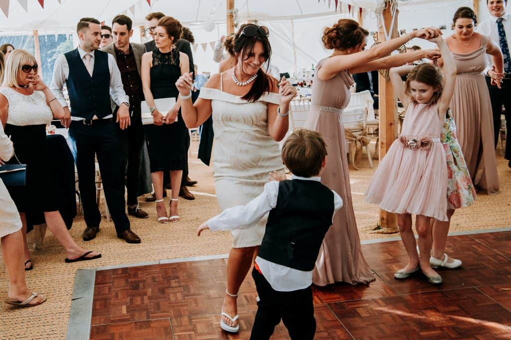 a busy dance floor at a marquee wedding
