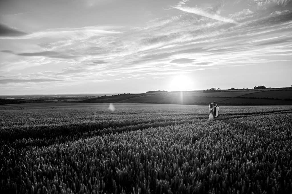 M and G Wedding photography photograph a couple at sunset in a golden field