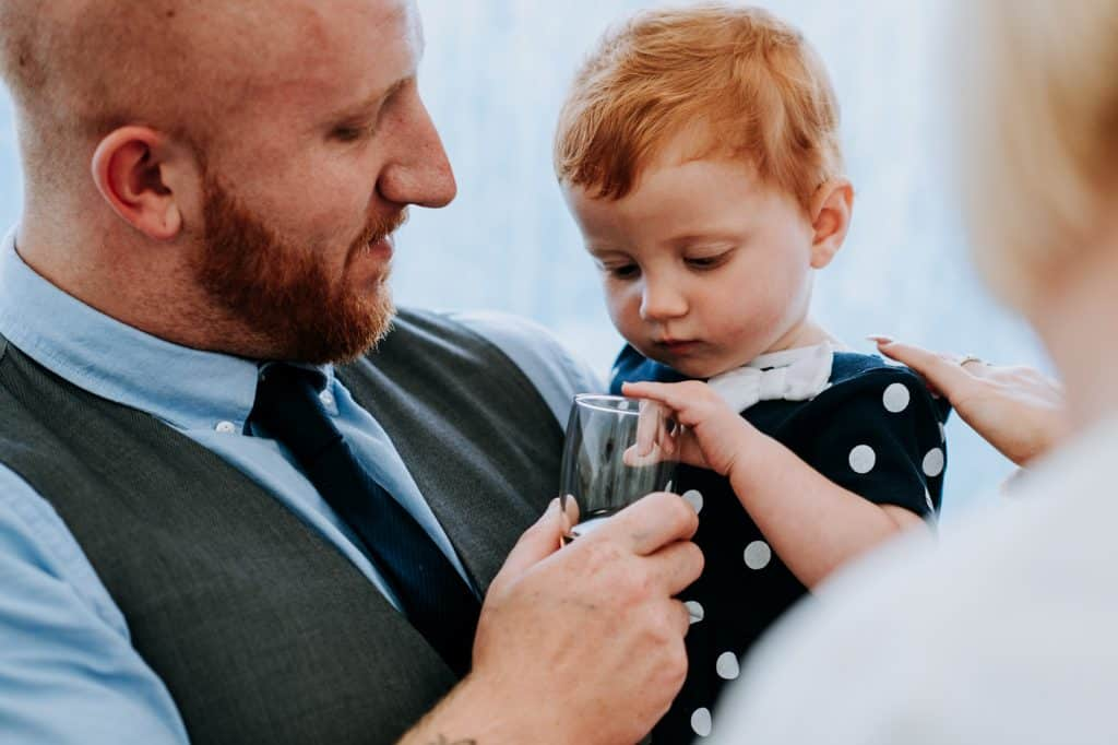 a toddler tries to steal a sip of her dads Little Wold wine
