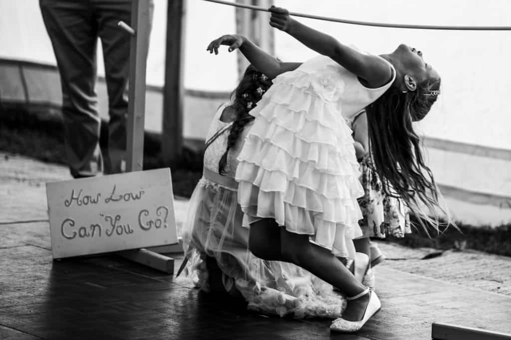 flowergirl bends over backwards during wedding games