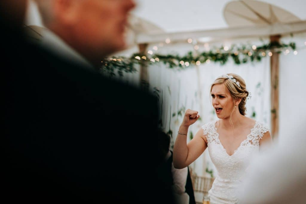 Bride cheers at Little Wold vineyard
