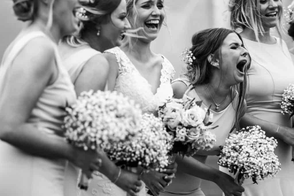 bridesmaids laughing during group shots