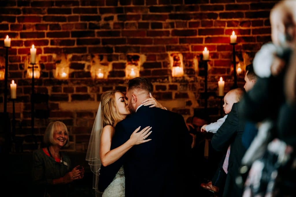 The first kiss between a bride and groom