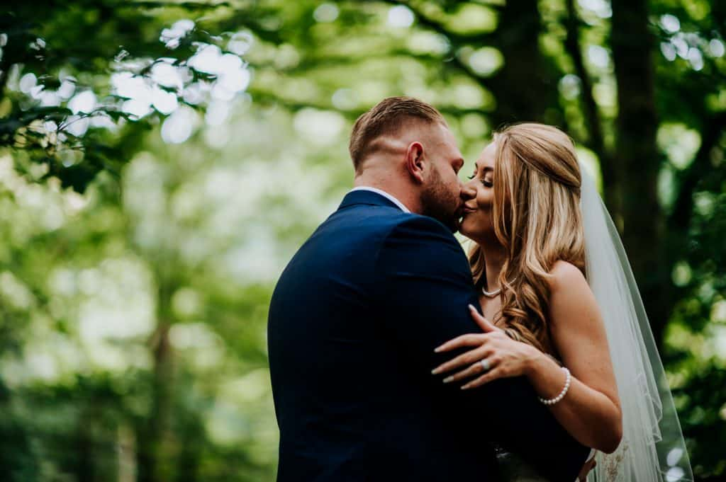 A bride and groom share a passionate kiss