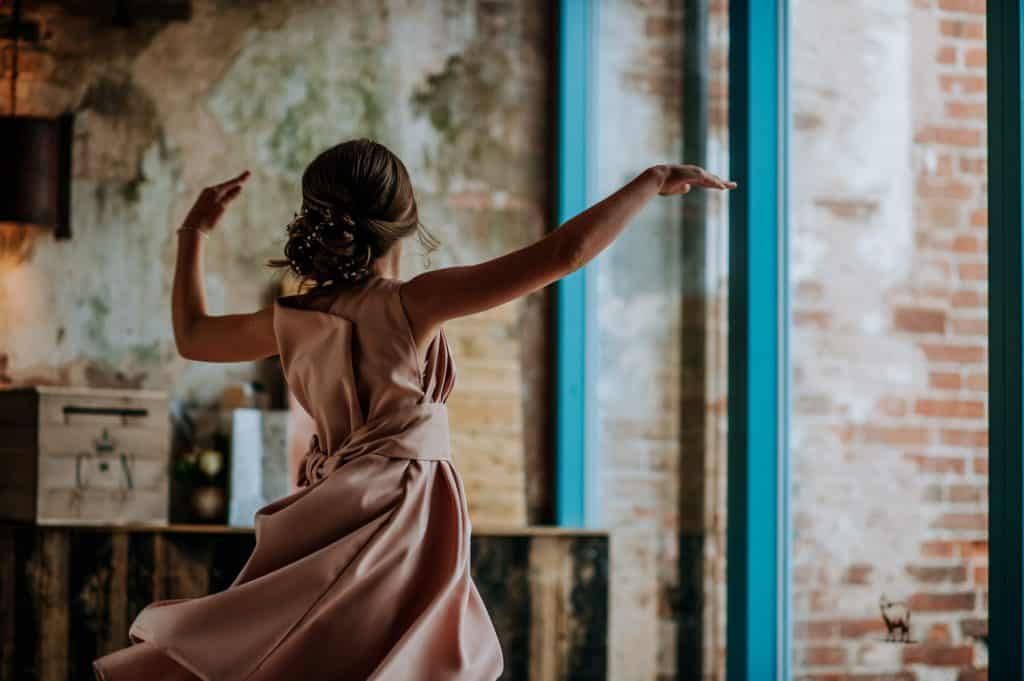 A young wedding guest dances