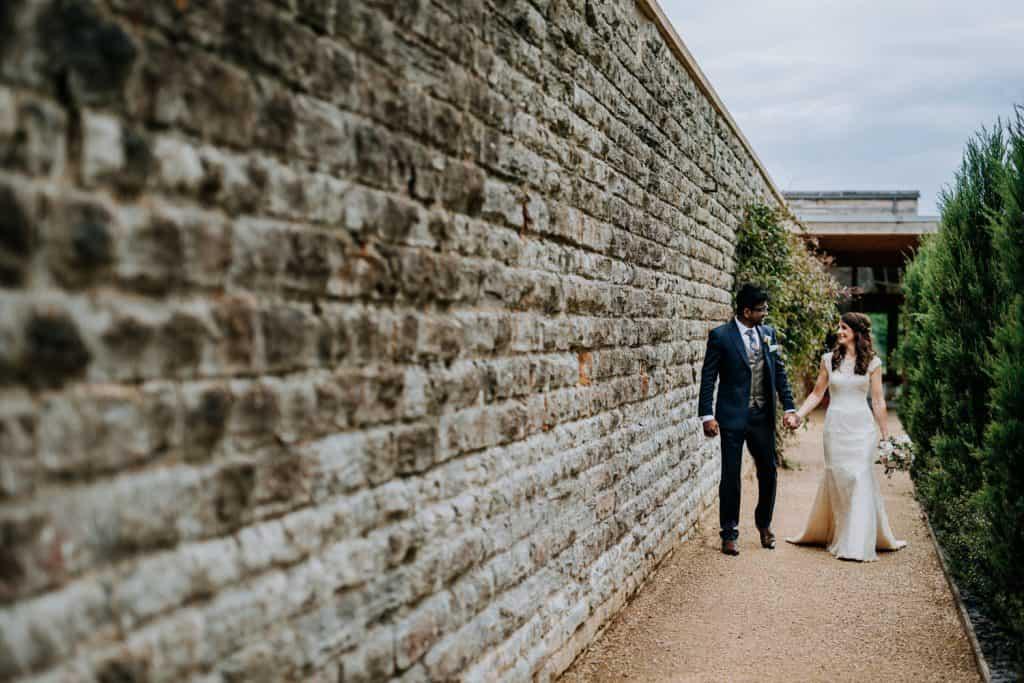 Husband and wife enjoying a walk around the beautiful Elmore Court grounds