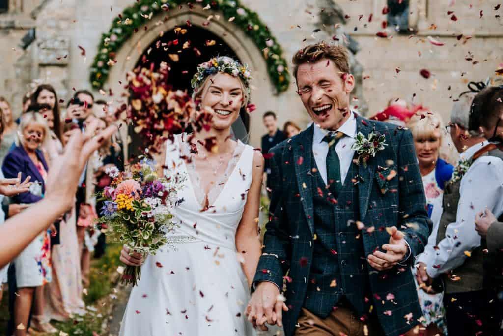 A joyous confetti moment as couple exit the church