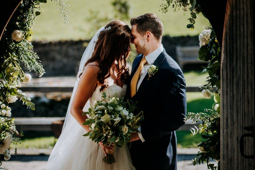Bride and groom share a tender moment together at Cripps Barn