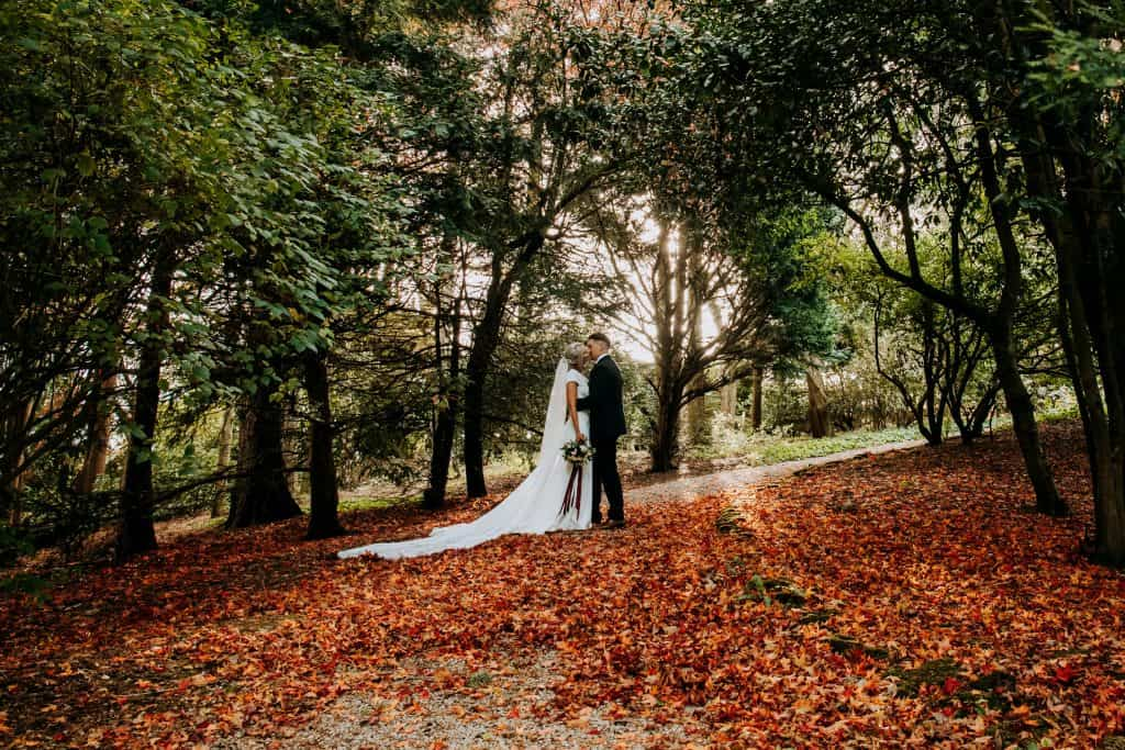 A romantic kiss surrounded by autumn leaves